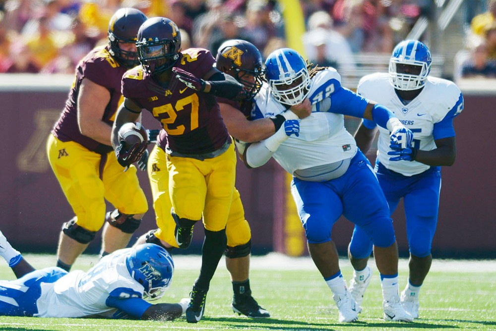 Minnesota running back David Cobb runs the ball against Middle Tennessee State on Saturday at TCF Bank Stadium.