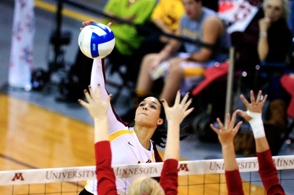 Minnesota outside hitter Daly Santana spikes during a match against Wisconsin on Oct. 17, 2012 at the Sports Pavilion.