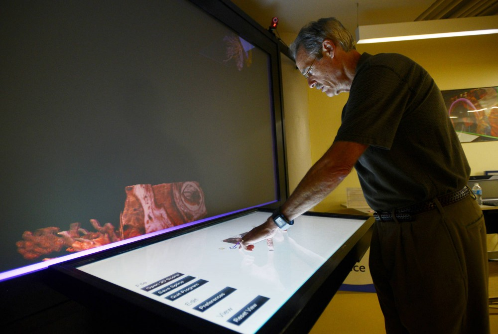 Professor Art Erdman uses the 3D Immersive Touch Table System in the Medical Devices Center in the Mayo Building on Thursday. The MDC, which uses student and faculty research to create breakthrough medical devices, is a leading center in its field.