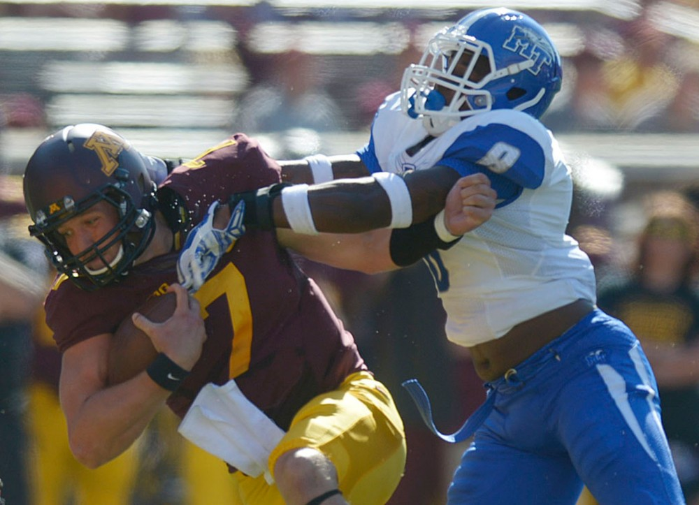 Minnesota's Mitch Leidner runs the ball against Middle Tennessee on Saturday at TCF Bank Stadium.