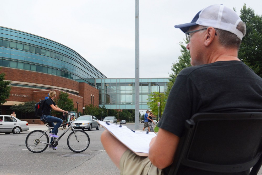 City of Minneapolis volunteer Dave Paulson tallies bicycle and pedestrian traffic on West Bank Tuesday. Counting occurs annually to monitor safety, traffic and infrastructure.