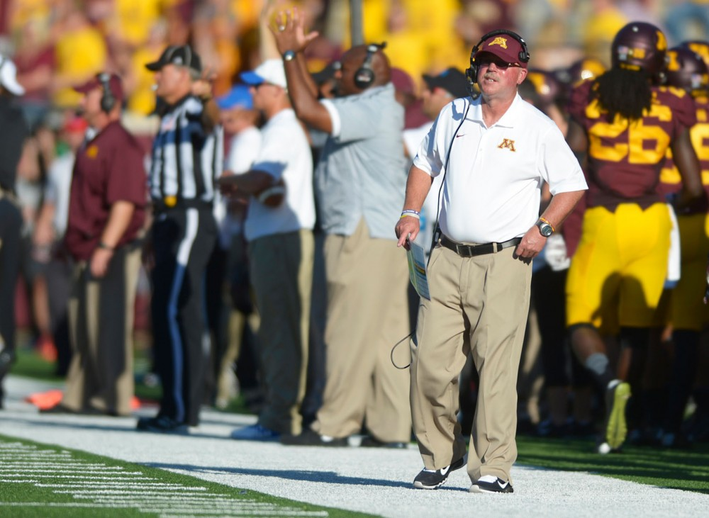 Head coach Jerry Kill waits for a call in between plays on Saturday, Sept. 6 against Middle Tennessee at TCF Bank Stadium.