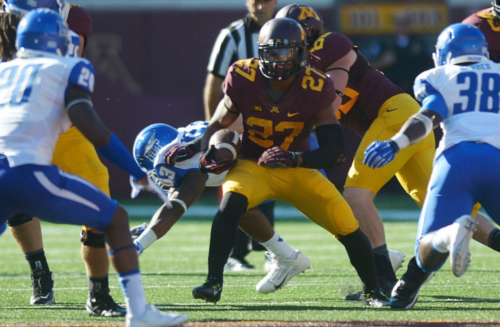 Minnesotas running back David Cobb avoids a tackle against Middle Tennessee on Saturday at TCF Bank Stadium.