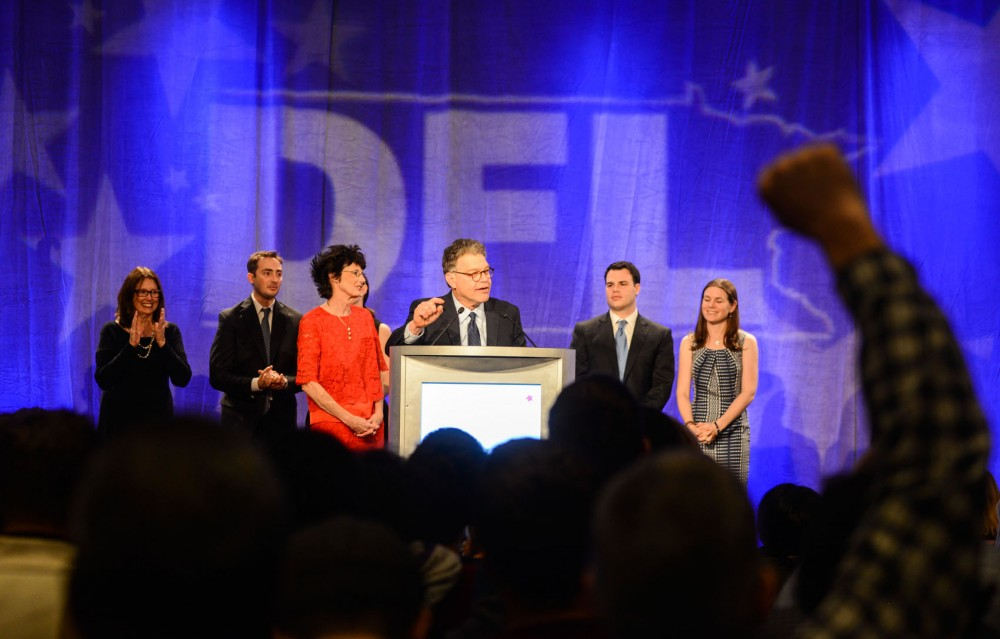 The crowd cheers as Sen. Al Franken speaks on stage with supporters on Tuesday evening at the DFL election night party at the Hilton in downtown Minneapolis.