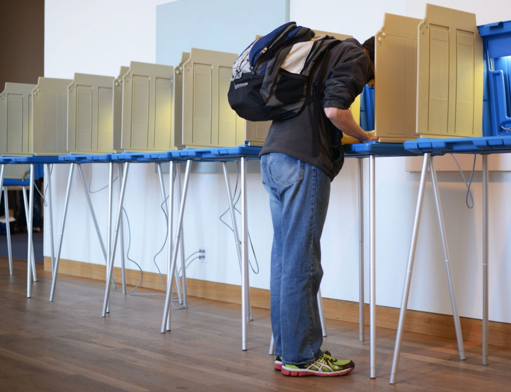 A students votes at the Weisman Art Museum on Tuesday, Nov. 4th. Voter turnout statewide was about 50 percent, lower than the last two midterm elections.