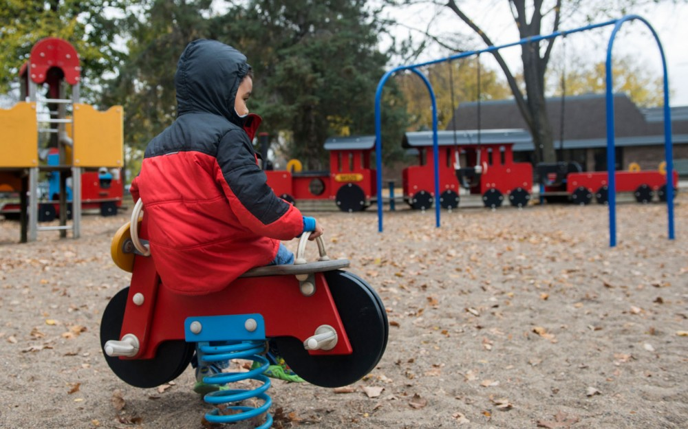 A child sits on a toy bike at Van Cleve Park on Thursday afternoon. The park board superintendent's proposed budget allocates about $300,000 to the park in 2020 to help improve its facilities.