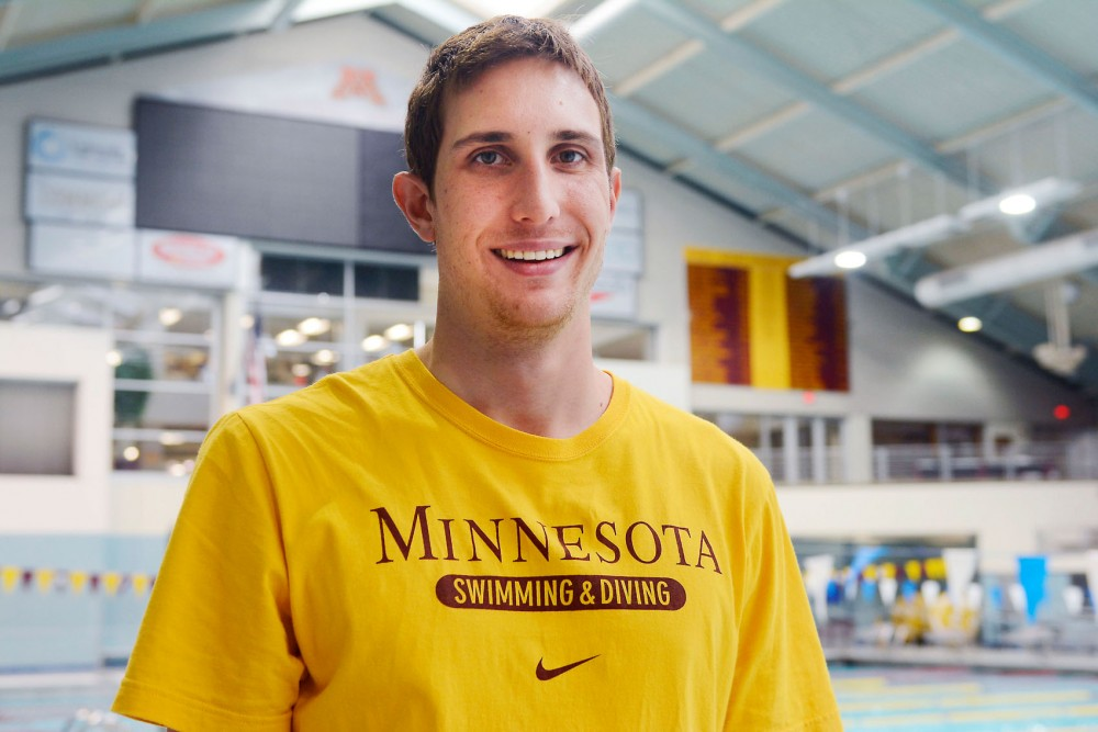First-year assistant swimming and diving coach Gideon Louw poses at the University Aquatic Center on Thursday afternoon. Louw competed in the 2008 and 2013 Olympic Games.