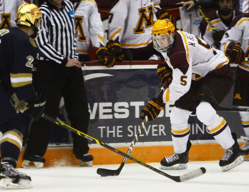 Minnesota defense Mike Reilly holds on to the puck Saturday at Mariucci Arena.