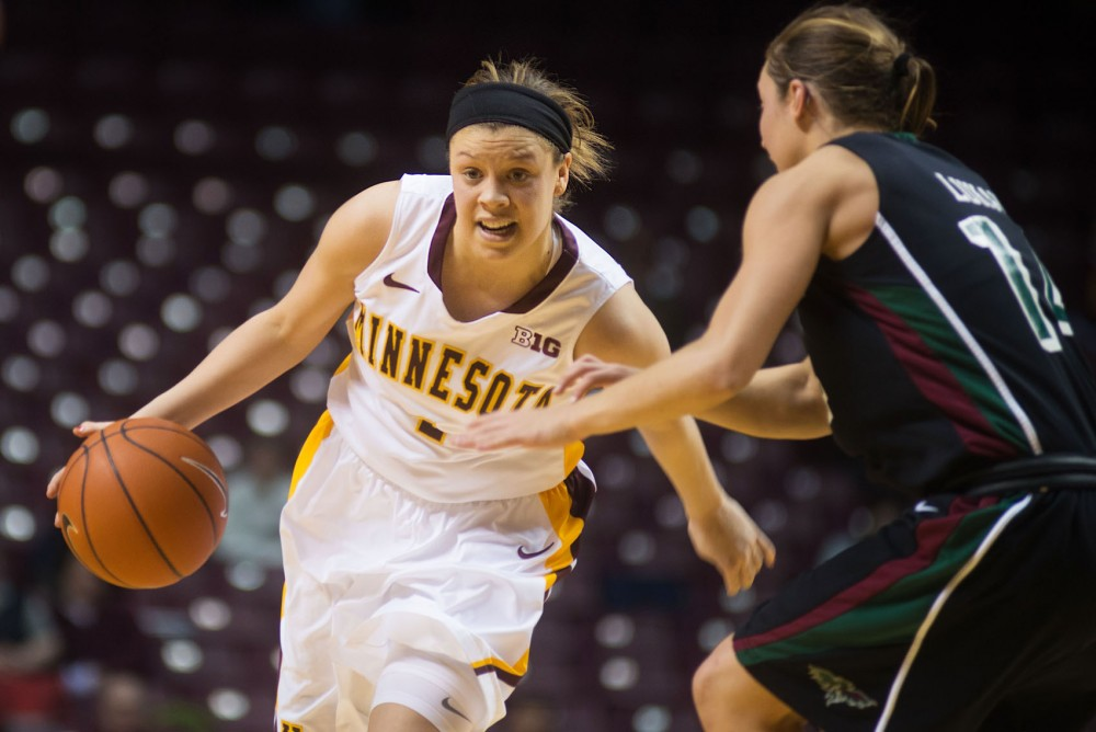 Minnesota guard Rachel Banham dribbles past Green Bay guard Megan Lukan on March 19, 2014 at Williams Arena.