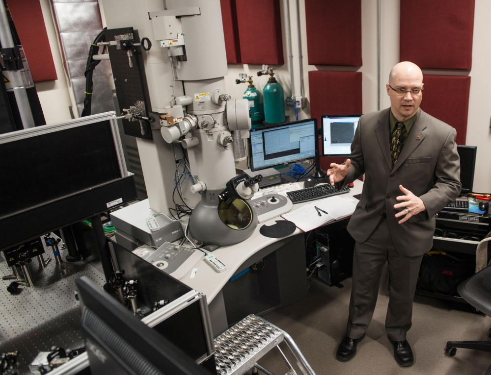 Assistant Professor David Flanningan speaks about the first in the world FEI Tecnai Femto ultrafast electron microscope during a media tour, Wednesday, Nov. 12 at Amundson Hall.