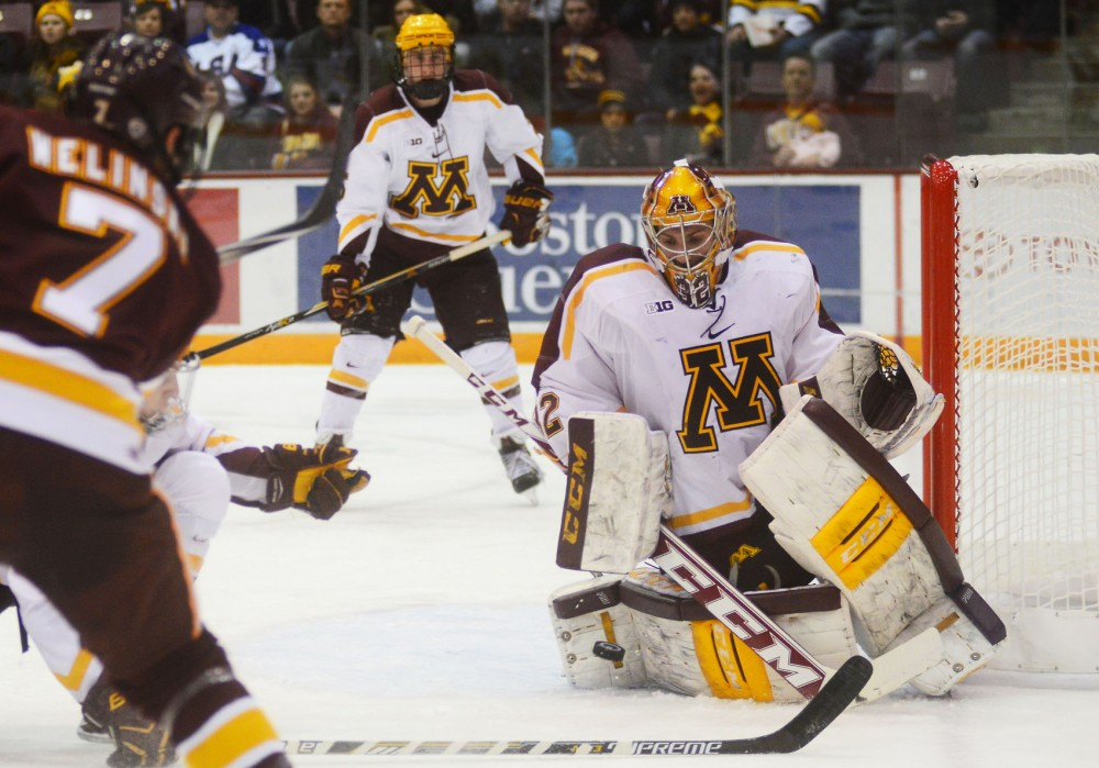 Goalie Adam Wilcox blocks a shot on Friday at Mariucci Arena at the game against UMD. The Bulldogs beat the Gophers 3-0.