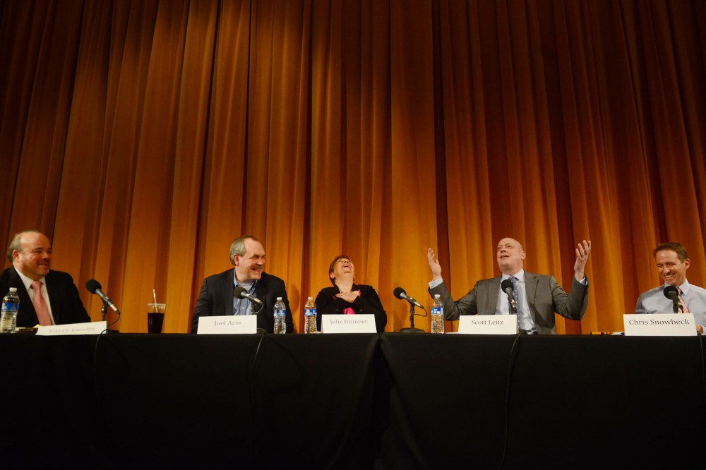 Larry Jacob, left, moderates a discussion with Joel Ario, Julie Brunner, Scott Lentz and Chris Snowbeck on the triumphs and failures of the first year of MNsure and any necessary changes on Friday afternoon at the Humphrey School of Business.