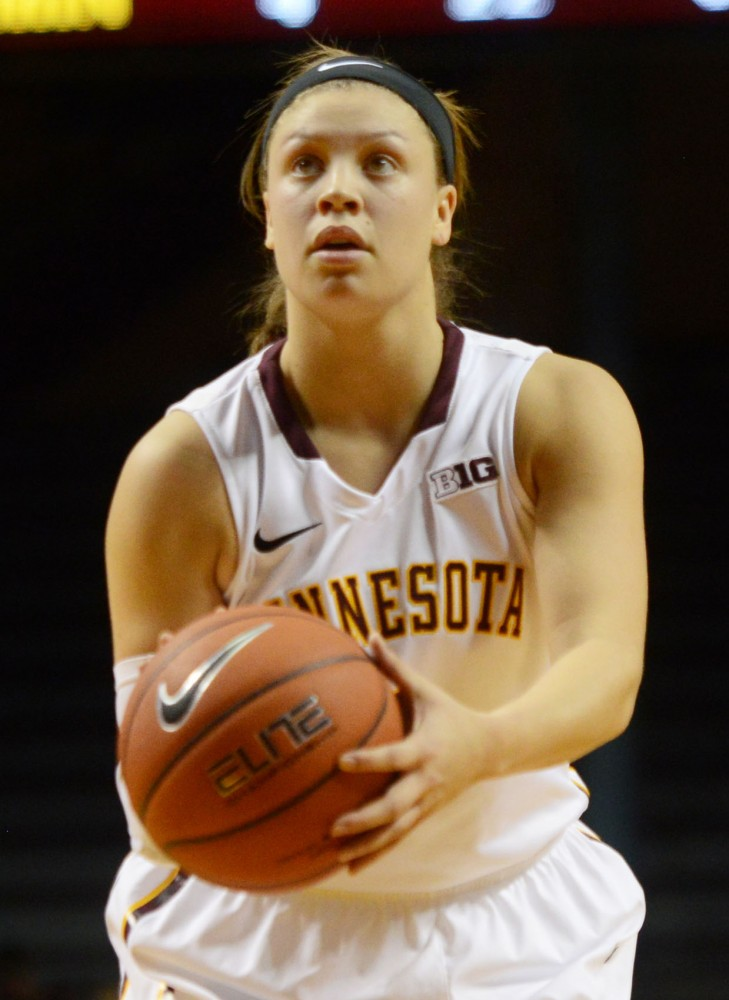 Senior Rachel Banham prepares to shoot at Williams Arena on Friday evening. Banham scored her 2,000th point Friday evening, becoming the fourth Gopher in program history to score 2,000 career points at the University of Minnesota.