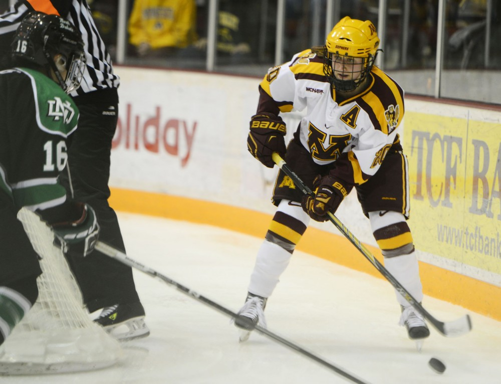 Senior Meghan Lorence carries the puck at the Gopher Women's Hockey game against North Dakota at the Ridder Arena on Friday.
