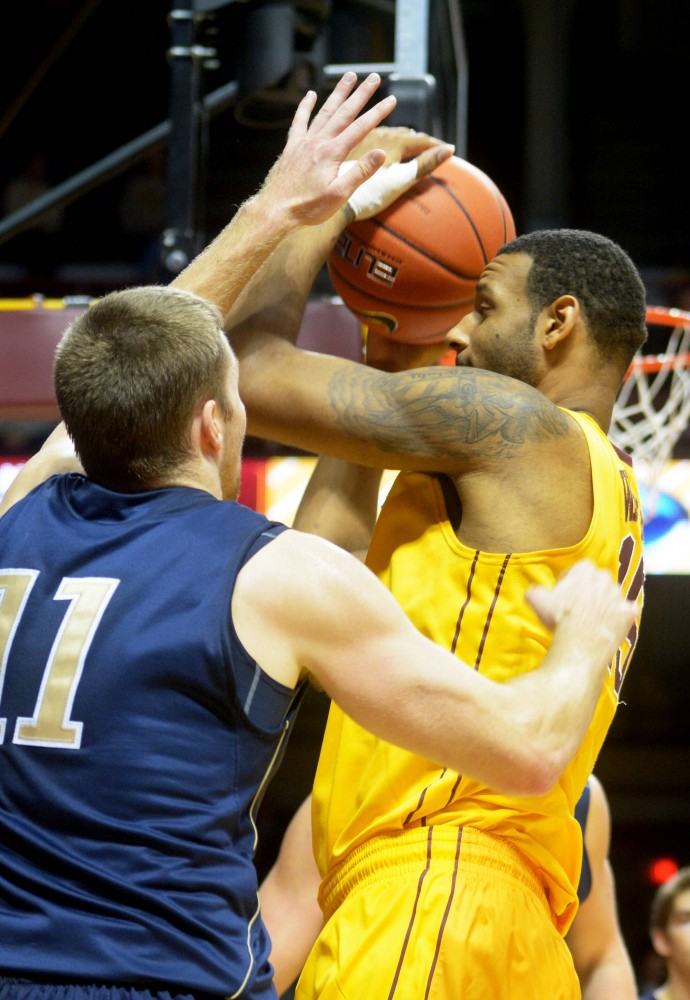 Minnesota center Mo Walker protects the ball against Concordia-St. Paul on Tuesday, Nov. 4, 2013, at Williams Arena.