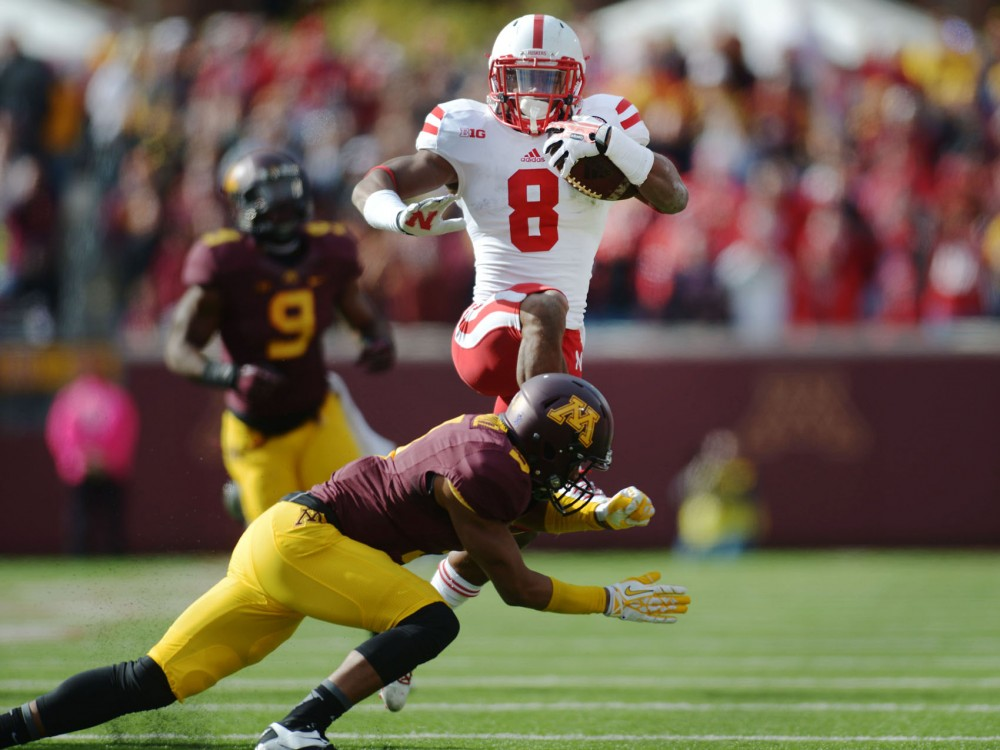 Nebraska running back Ameer Abdullah rushes for 165 yards on Saturday, Oct 26 against the Gophers at TCF Bank Stadium.