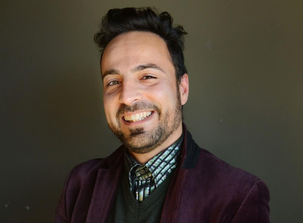 Writer Qais Munhazim poses at the Purple Onion Friday afternoon.