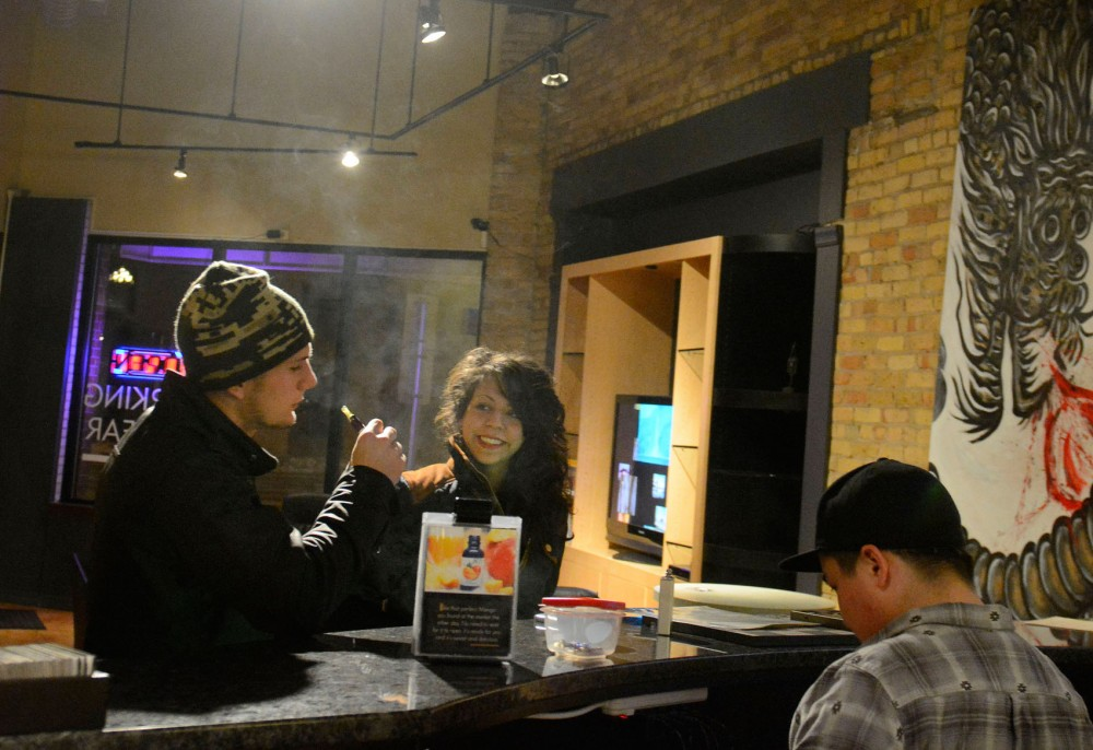 Nate Stevensen and Alysia Urbina tests different e-cigarette flavors at Smokeless Smoking Vapor Shop on Tuesday evening.