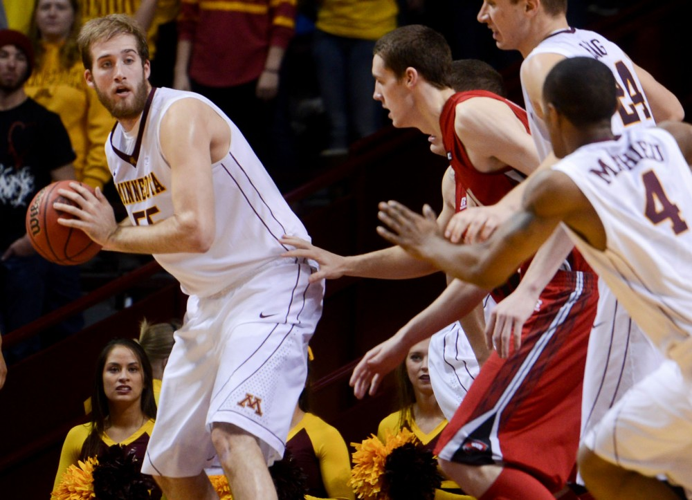 Minnesota center Elliott Eliason looks for a pass Tuesday at Williams Arena.