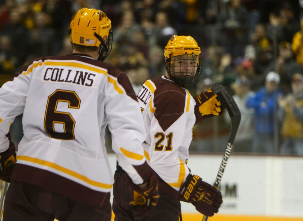 Sophomore forward Connor Reilly celebrates with teammate Ryan Collins after scoring a goal during the Gopher Men's Hockey game against St. Cloud State University on Saturda, Nov. 1 at the Mariucci Arena.