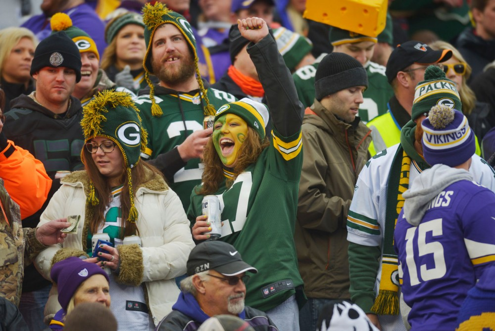 Packers fans cheer after a touchdown on Nov. 23, 2014, at TCF Bank Stadium. The Vikings lost 24-21 to the Packers.