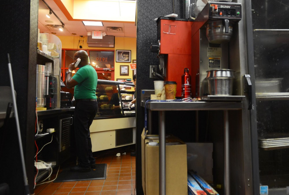 Afro Deli owner Abdirahman Kahin takes orders at the restaurant Wednesday night. A proposed ordinance change would allow businesses to stay open for longer than normal 35 days a year. The change is geared toward  Muslim-owned businesses who weren't able to stay open as late as they wanted during Ramadan.