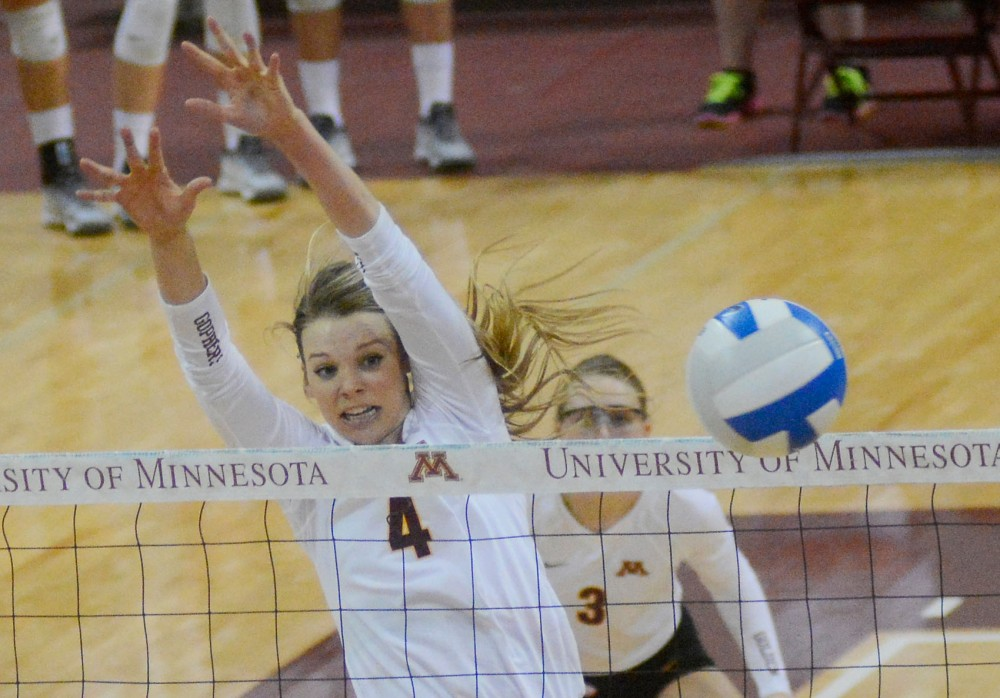 Sophomore Paige Tapp blocks the ball on Saturday at the Sports Pavilion at the match against Purdue. The Gophers won 3-0.