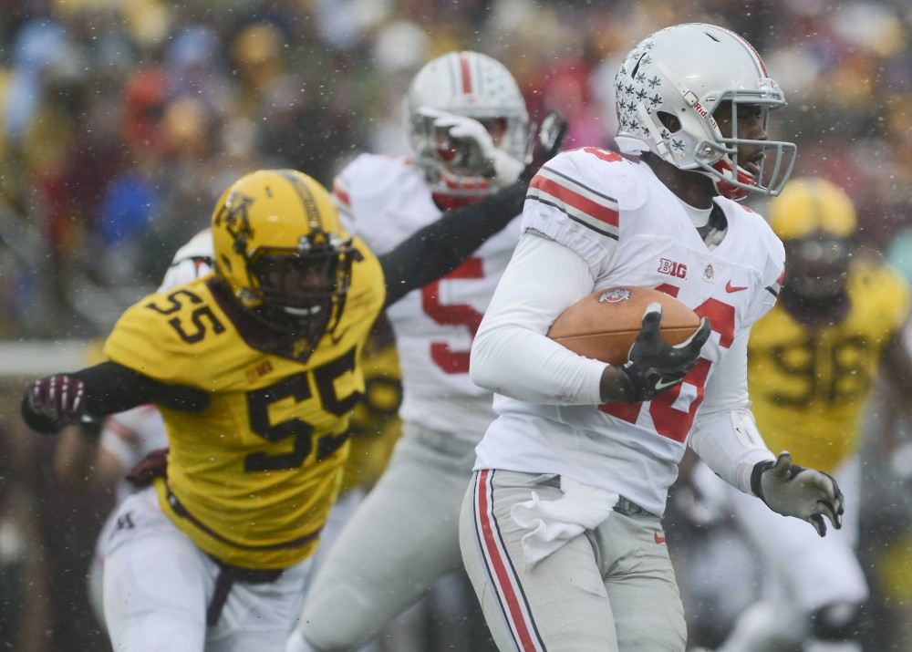 Ohio State quarterback J.T. Barrett runs the ball on Saturday, Nov. 15 at TCF Bank Stadium.