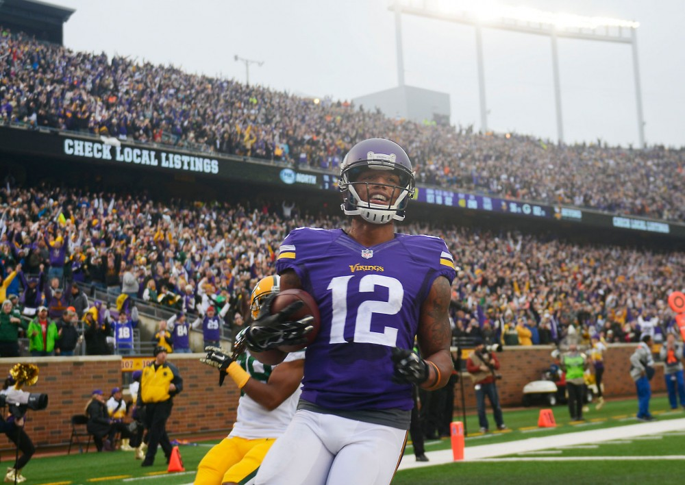 Minnesota wide receiver Charles Johnson scores a touchdown Sunday at TCF Bank Stadium.