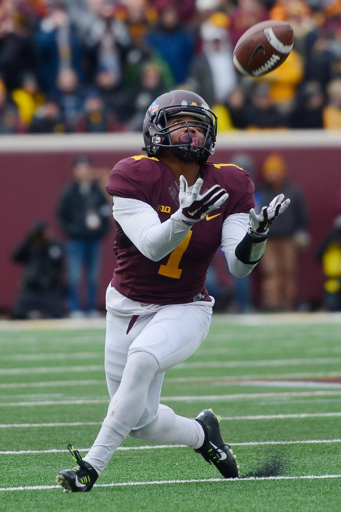 Wide receiver KJ Maye reaches to catch the ball on Saturday at TCF Bank Stadium.