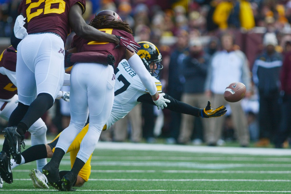 Iowa wide receiver Jacob Hillyer reaches for the ball on Saturday at TCF Bank Stadium.