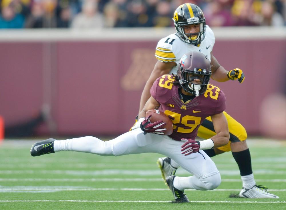 Minnesota defensive back Briean Boddy-Calhoun intercepts the ball on Saturday at TCF Bank Stadium.