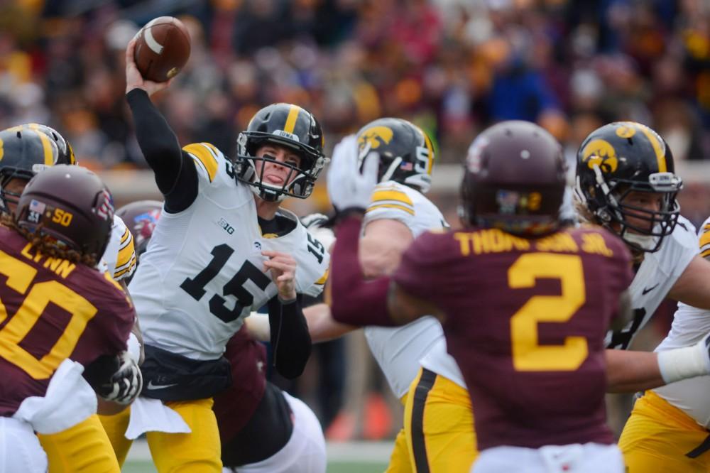 Iowa quarterback Jake Rudock passes the ball on Saturday at TCF Bank Stadium.