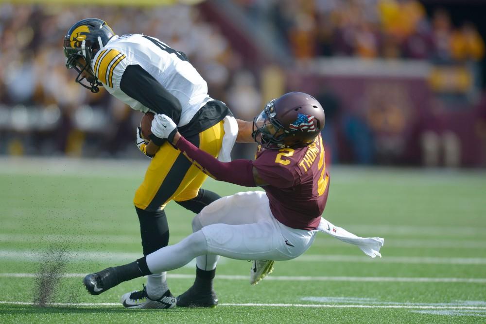 Minnesota defensive back Cedric Thompson tackles a Hawkeye on Saturday at TCF Bank Stadium.