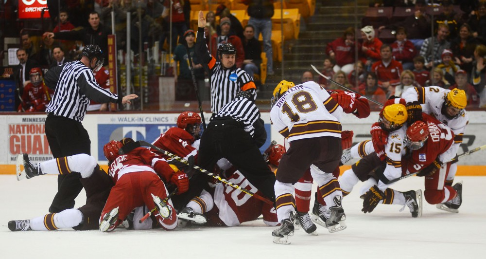 Minnesota Gophers and Wisconsin Badgers brawl on the ice of Mariucci Arena during the third period of the final game in the 24th Annual Mariucci Classic on Saturday. Seventeen out of 28 total combined penalties were given in the third period.