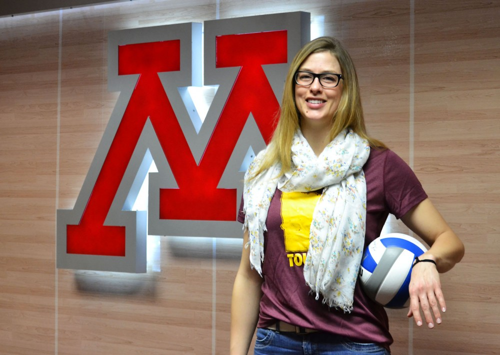 Minnesota assistant volleyball coach Laura Benzing poses in the volleyball lounge Thursday evening. Benzing was recently hired by head volleyball coach Hugh McCutcheon.
