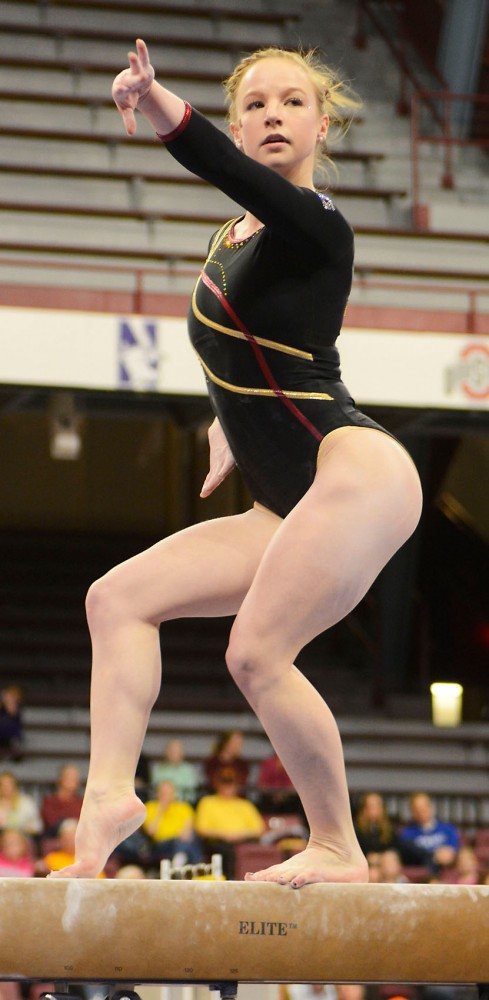 Junior Lindsay Mable poses during her beam routine at the Sports Pavilion on Saturday afternoon.