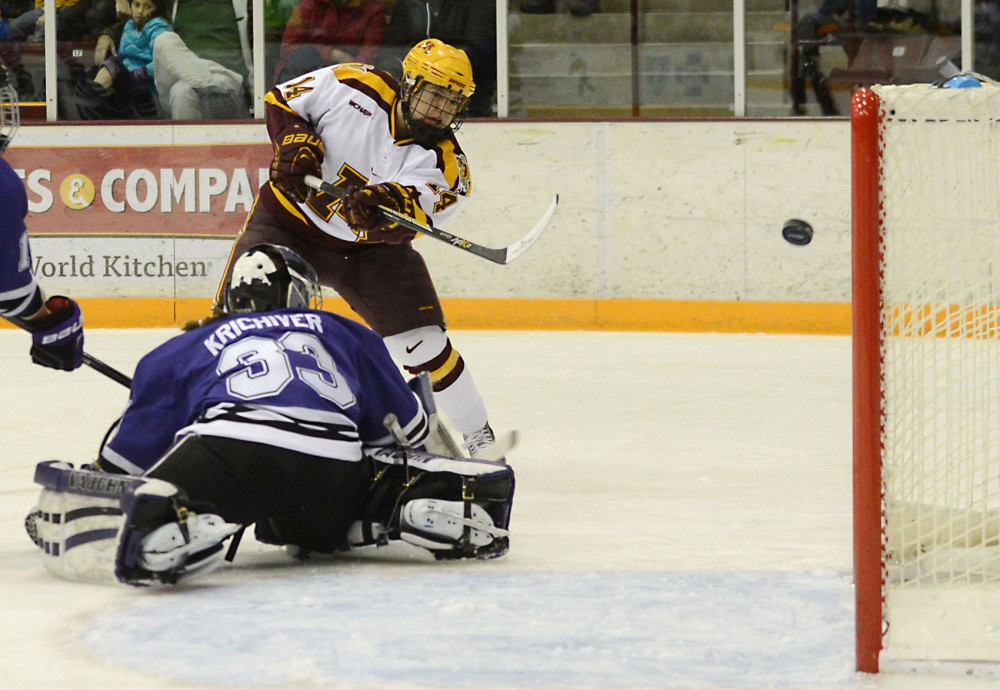 Forward Maryanne Menefee shoots the puck against Minnesota State Mankato on Saturday at Ridder Arena.
