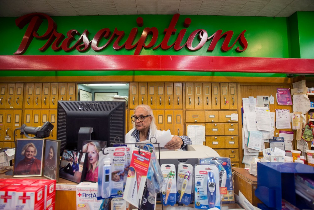 Owner of Schneider Drug Tom Sengupta works at his store on Thursday in St. Paul.  Sengupta will be leaving the store after operating it for over 43 years.