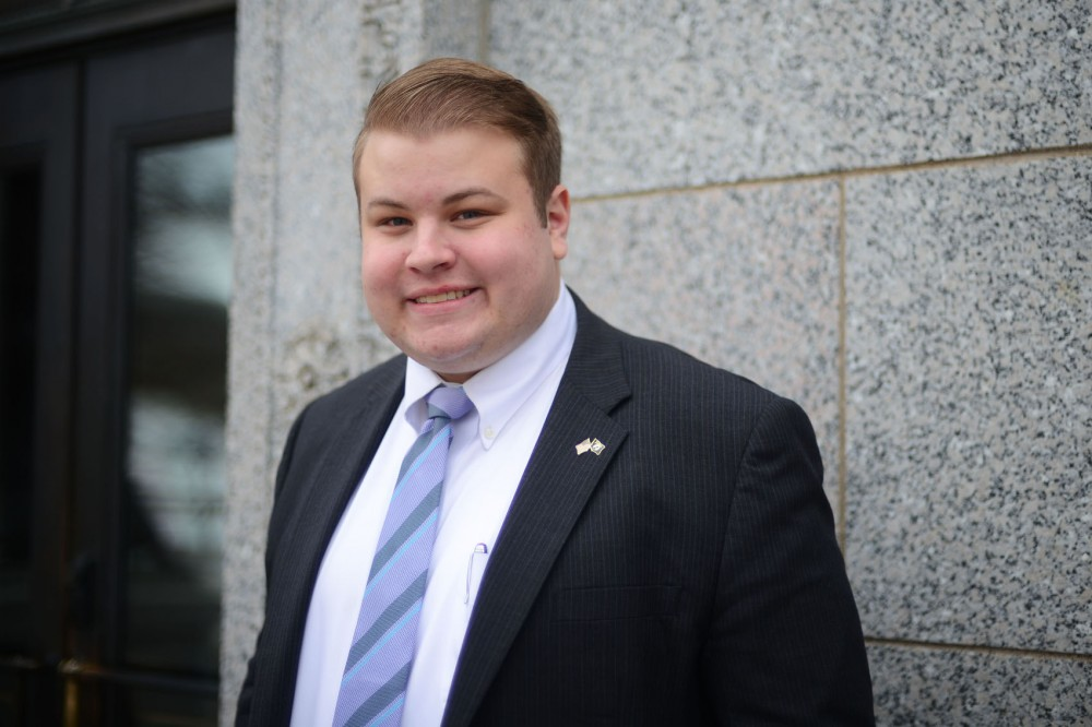 Rep. Drew Christensen, R-Savage, poses for a photograph outside the State Office Building on Wednesday. He is a University student and the youngest member of the state Legislature this session.