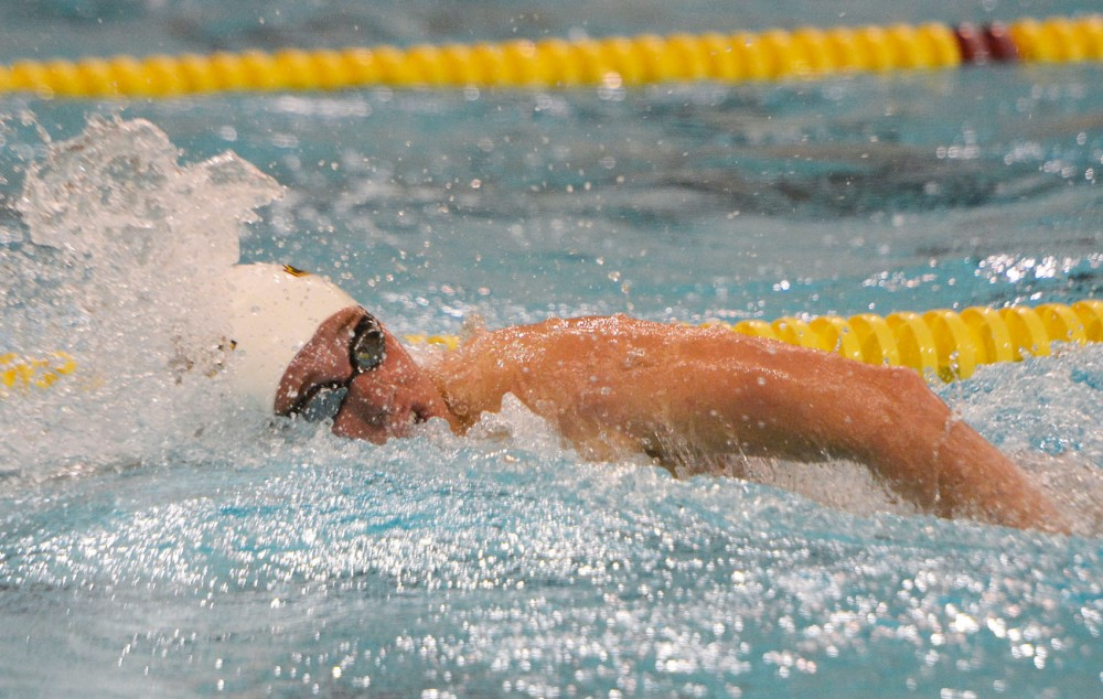 CJ Smith swims at the University Aquatic Center against Wisconsin on Friday, Oct. 17.
