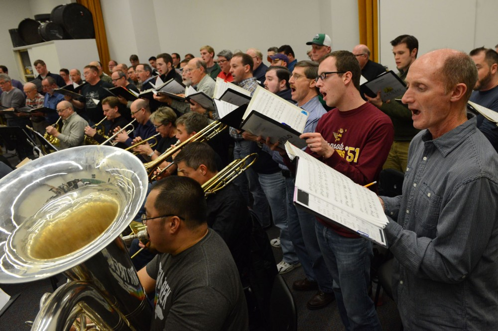 The members of the show Liberation of Auschwitz rehearse on Sunday at Augsburgs Anderson Music Hall. The show, which includes a male chorus, solo baritone, orchestra and a dancer, premieres on Tuesday at the Ted Mann Concert Hall in honor of the 70th anniversary of the liberation of the Auschwitz concentration camp.