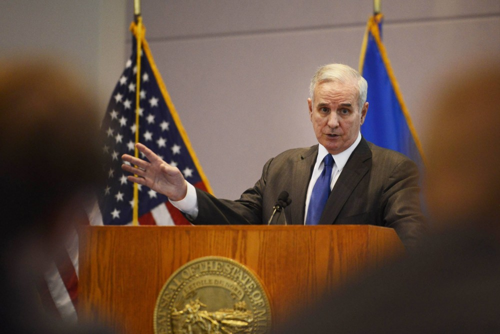 Gov. Mark Dayton fields questions on his $42 billion budget proposal at the Minnesota Department of Revenue on Tuesday. His proposed budget allocates only about half of the University of Minnesota's request to continue a tuition freeze for undergraduate students who pay in-state tuition and resident graduate students.