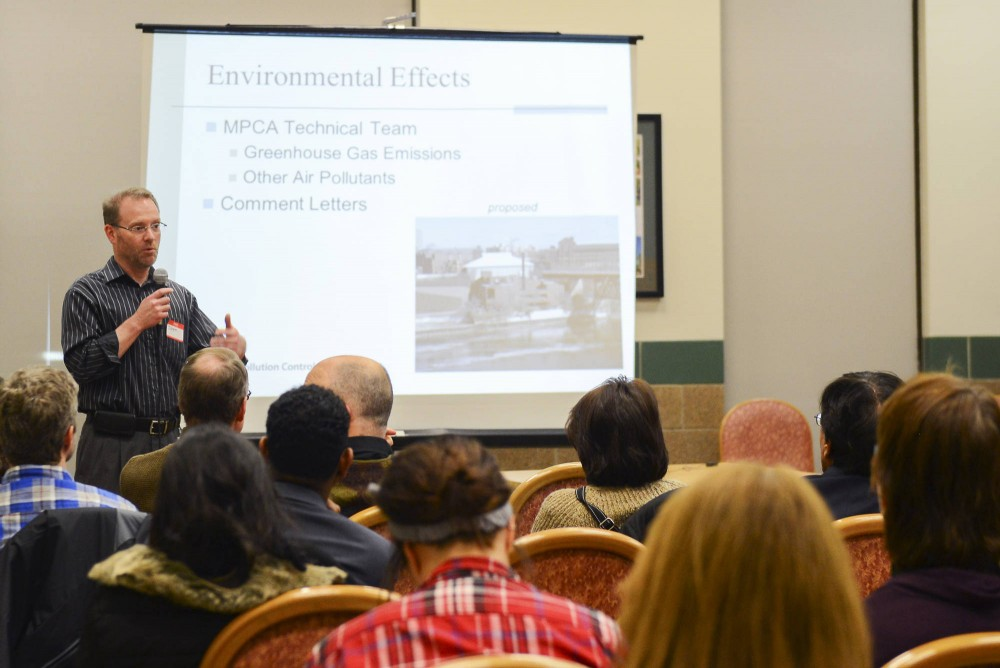 Director of Industrial Division Jeff Smith speaks Thursday night in the Cedar-Riverside neighborhood. The Minnesota Pollution Control Agency (MPCA) voted unanimously to allow construction on the steam plant Tuesday.