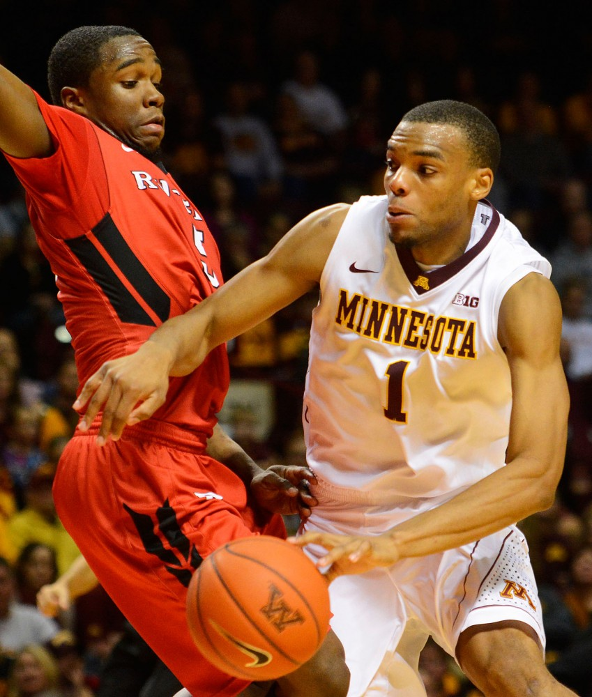 Minnesota guard Andre Hollins dribbles past Rutgers guard Mike Williams in the second half at Williams Arena on Jan. 17.