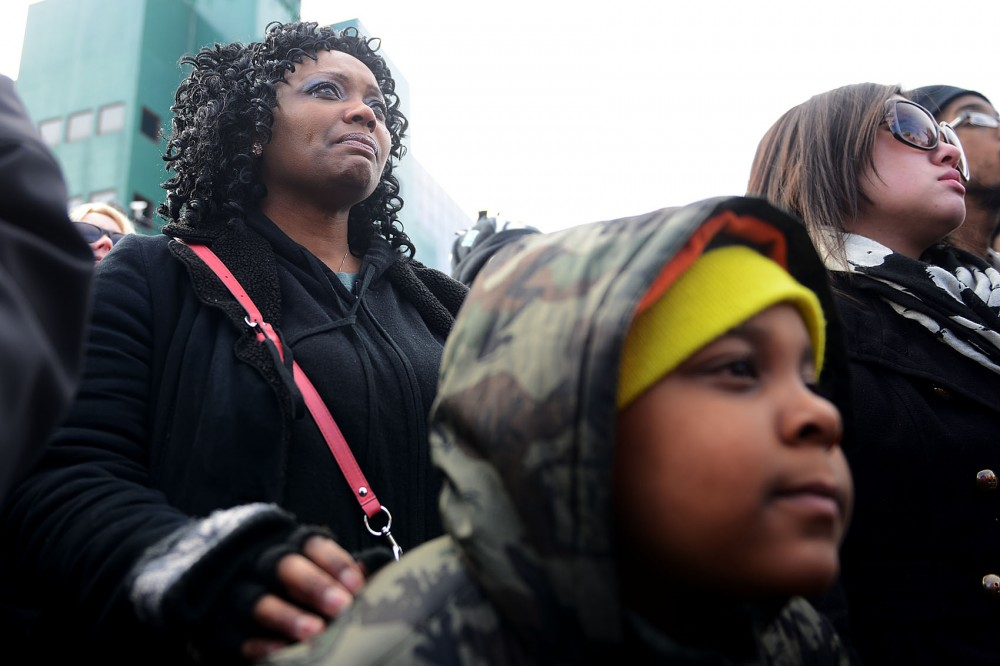 Jennifer Oliver tears up while resting her hand on Brycen Petrie's shoulder at the beginning of the march on Monday in St. Paul.