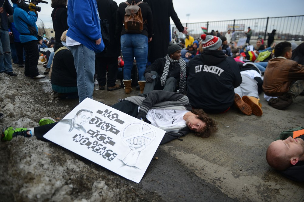 A demonstrator lies motionless while participating in a