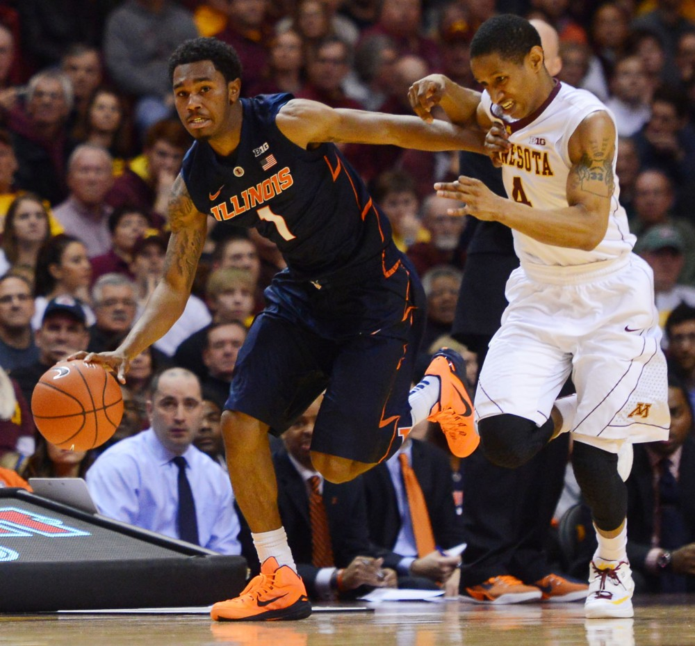 Illinois guard Jaylon Tate pushes guard DeAndre Mathieu out of the way on Saturday at Williams Arena.