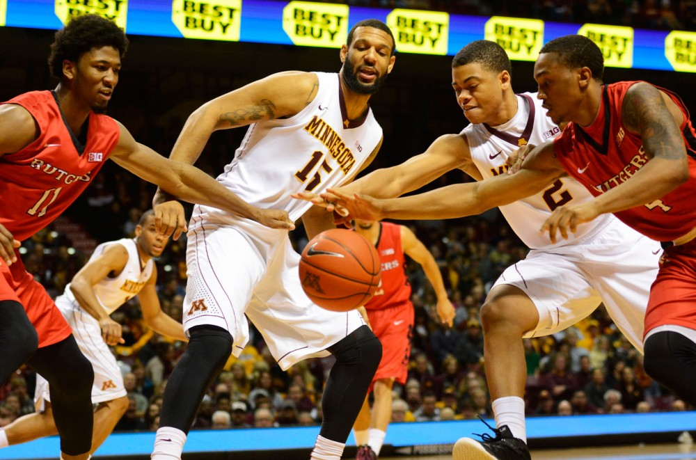 Minnesota center Maurice Walker and guard Nate Mason fight for the ball against Rutgers in the first half at Williams Arena on Saturday, January 17, 2015.