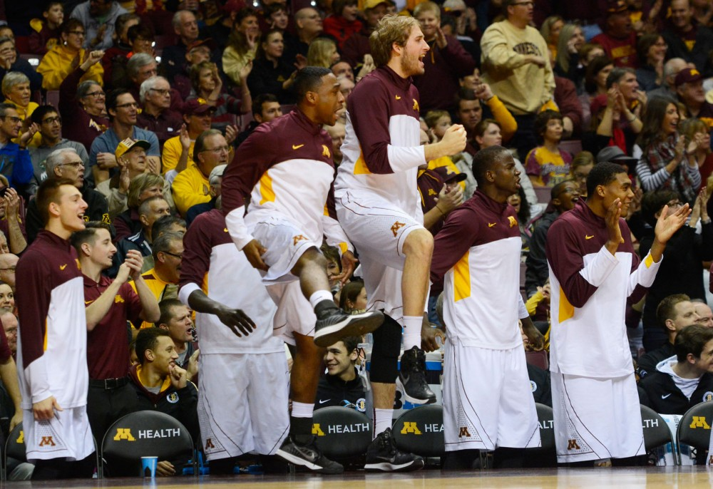 The Minnesota bench reacts to Maurice Walker's first dunk of the game against Rutgers in the first half at Williams Arena on Saturday, January 17, 2015.
